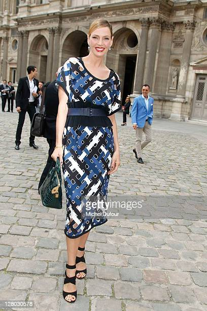 Uma Thurman attends the Louis Vuitton Ready to Wear Spring / Summer 2012 show during Paris Fashion Week on October 5 2011 in Paris France