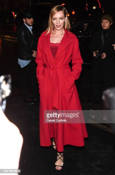Uma Thurman is seen wearing a red coat outside the Versace PreFall 2019 Collection on December 2 2018 in New York City