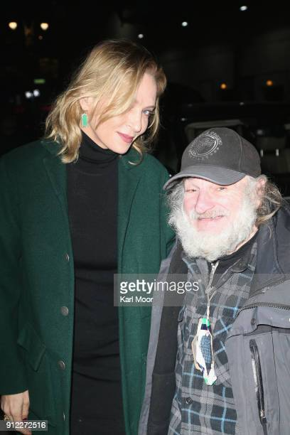 Uma Thurman poses for pictures with Craig Castaldo aka Radioman as she arrives for her taping of 'The Late Show With Stephen Colbert' at Ed Sullivan...