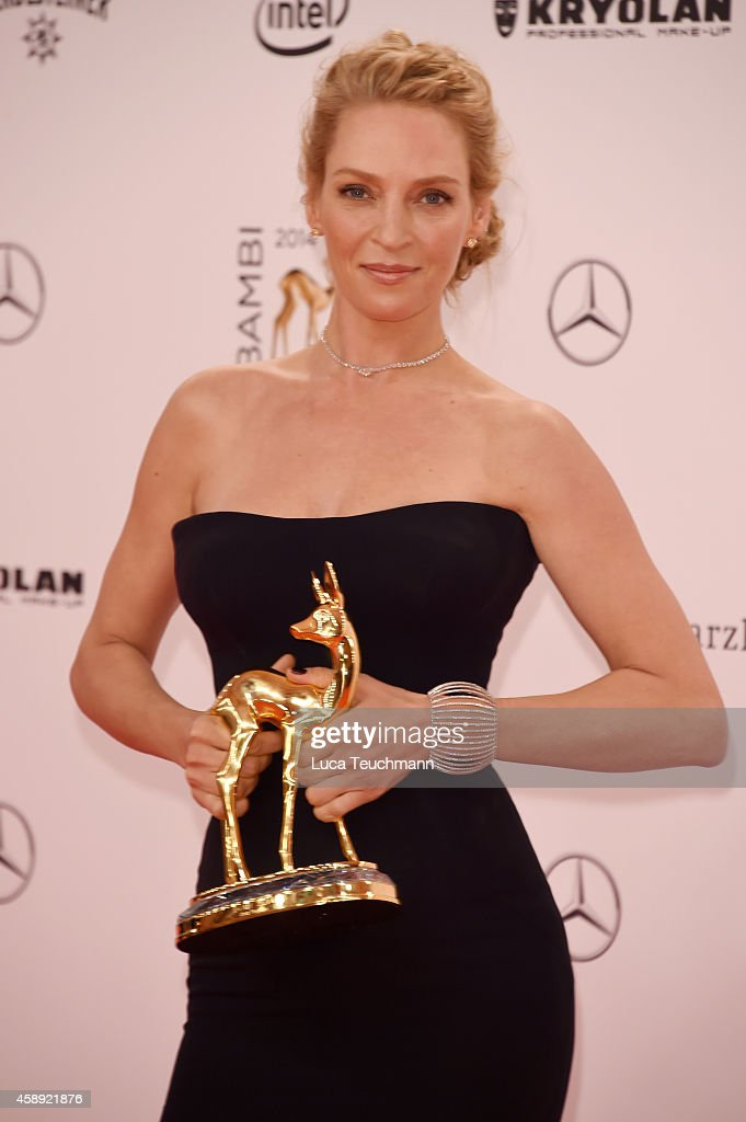 Uma Thurman poses with her award during Kryolan at the Bambi Awards 2014 on November 13, 2014 in Berlin, Germany.