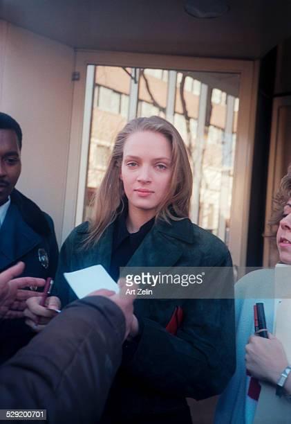 Uma Thurman signing autographs; circa 1990; New York.