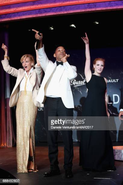 Uma Thurman Will Smith and Jessica Chastain attend the amfAR Gala Cannes 2017 at Hotel du CapEdenRoc on May 25 2017 in Cap d'Antibes France