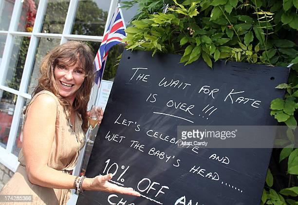 Uma Wylde poses outside the Oxford Wine Company shop as she has a toast to celebrate the Royal birth on July 23 2013 in Tetbury England Catherine...