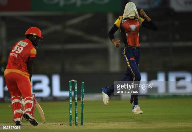 Umaid Asif of Peshawar Zalmi celebrates after clean bowled CAK Walton of Islamabad United during the Pakistan Super League final match between...