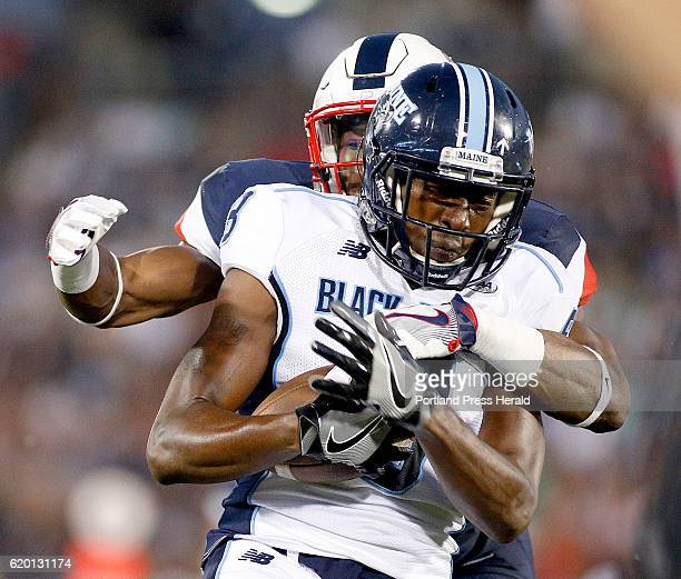 UMaine's Jaleel Reed breaks away from UConn defender Obi Melifonwu breaks down UMaine's Jaleel Reed after Reed broke away for a long gainer in the...