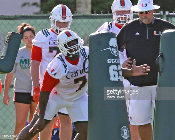 UMaposs DL Kendrick Norton hits the dummies at the University of Miami's first day of football practice for the 2017 season on Tuesday Aug 1 2017 in...