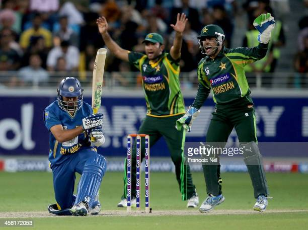 Umar Akmal and Sohaib Maqsood of Pakistan appeal the wicket of TM Dilshan of Sri Lanka during the second OneDay International match between Sri Lanka...