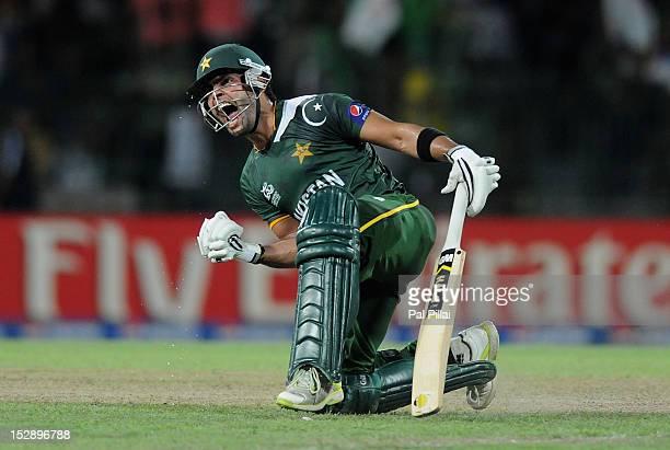 Umar Akmal of Pakistan celebrates as Pakistan wins the super eight match between Pakistan and South Africa at R Premadasa Stadium on September 28...