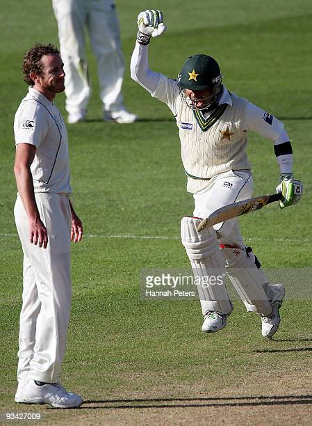Umar Akmal of Pakistan celebrates scoring his maiden test century during day three of the First Test match between New Zealand and Pakistan at...
