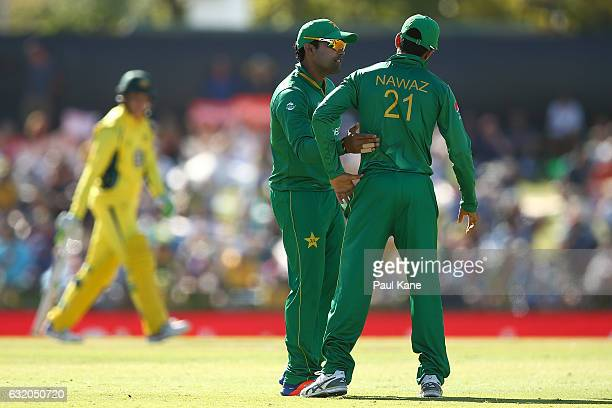 Umar Akmal of Pakistan consoles Mohammad Nawaz of Pakistan after dropping Peter Handscomb of Australia during game three of the One Day International...