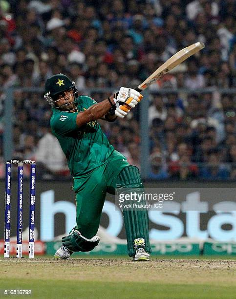 Umar Akmal of Pakistan hits a shot during the ICC World Twenty20 India 2016 match between Pakistan and India at Eden Gardens on March 19 2016 in...