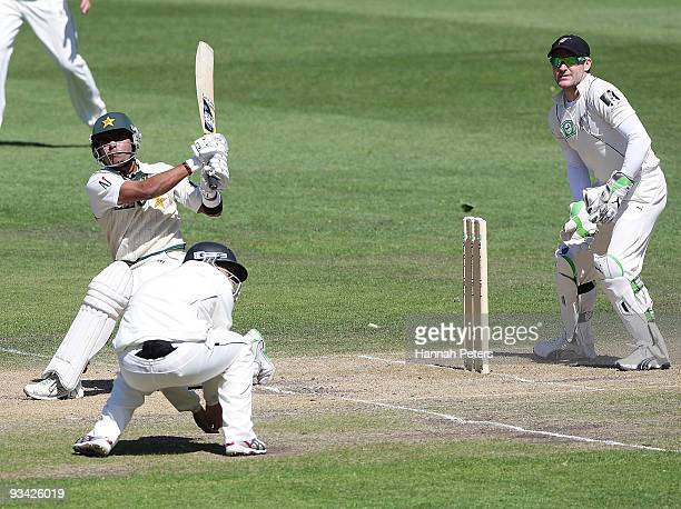 Umar Akmal of Pakistan hits the ball for six runs during day three of the First Test match between New Zealand and Pakistan at University Oval on...