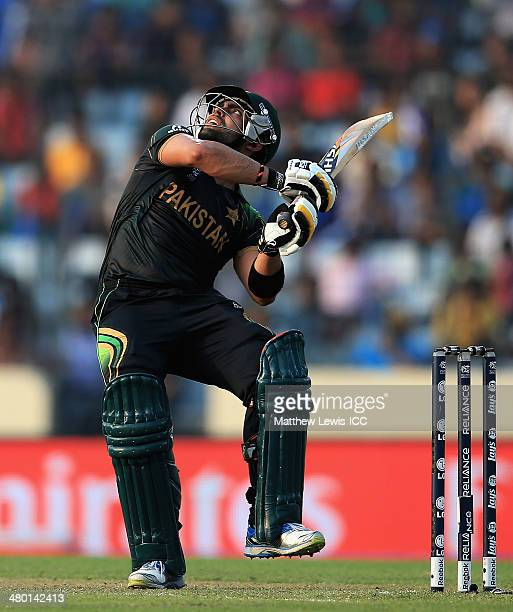 Umar Akmal of Pakistan hits the ball towards the boundary during the ICC World Twenty20 Bangladesh 2014 match between Pakistan and Australia at...