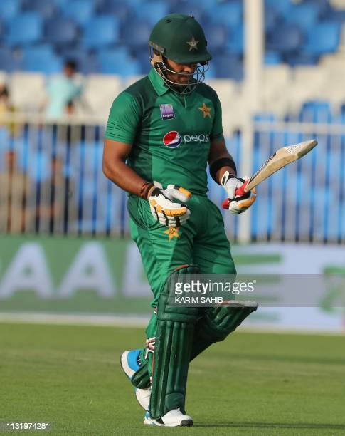 Umar Akmal of Pakistan leaves the field after being dismissed by Nathan CoulterNile of Australia during the first oneday international cricket match...