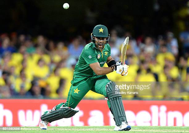 Umar Akmal of Pakistan plays a shot during game one of the One Day International series between Australia and Pakistan at The Gabba on January 13...