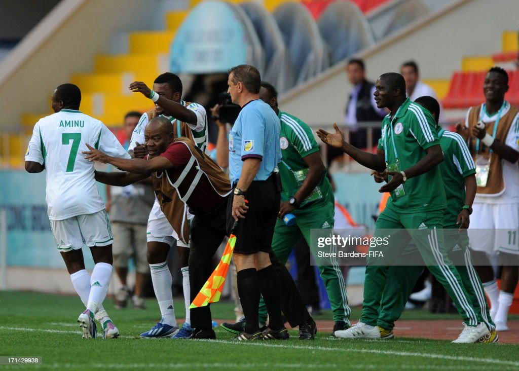 Umar Aminu (L) of Nigeria celebrates scoring his 2nd goal with his manager John Obuh and the Nigeria substitutes during the FIFA U-20 World Cup Group B match between Cuba and Nigeria at Kadir Has Stadium on June 24, 2013 in Kayseri, Turkey.