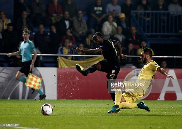 Umar Aminu of Osmanlispor in action against Victor Ruiz of Villarreal during the UEFA Europa League Group L football match between Villarreal and...