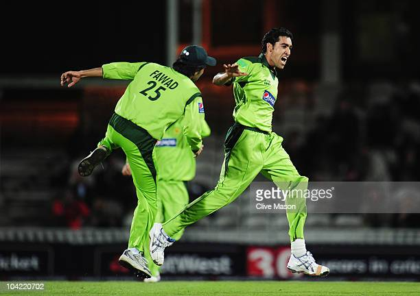 Umar Gul of Pakistan celebrates the wicket of Graeme Swann of England with Fawad Alam during the 3rd NatWest One Day International between England...