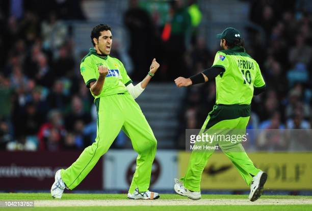 Umar Gul of Pakistan celebrates the wicket of Michael Yardy of England with Shahid Afridi during the 3rd NatWest One Day International between...