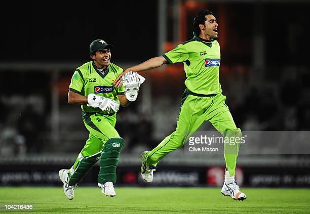Umar Gul of Pakistan celebrates the wicket of Stuart Broad of England with Umar Akmal during the 3rd NatWest One Day International between England...