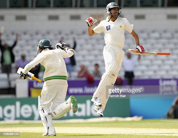 Umar Gul of Pakistan celebrates with team mate Mohammad Aamer after hitting the winning runs during day four of the 2nd Test between Pakistan and...