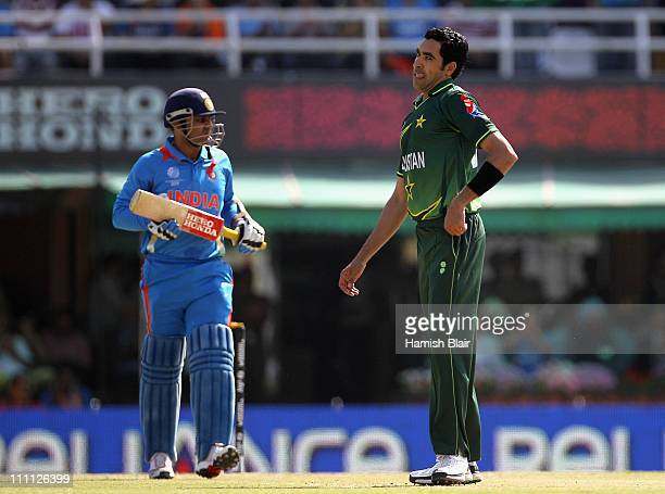 Umar Gul of Pakistan looks on after being hit for four by Virender Sehwag of India during the 2011 ICC World Cup second SemiFinal between Pakistan...