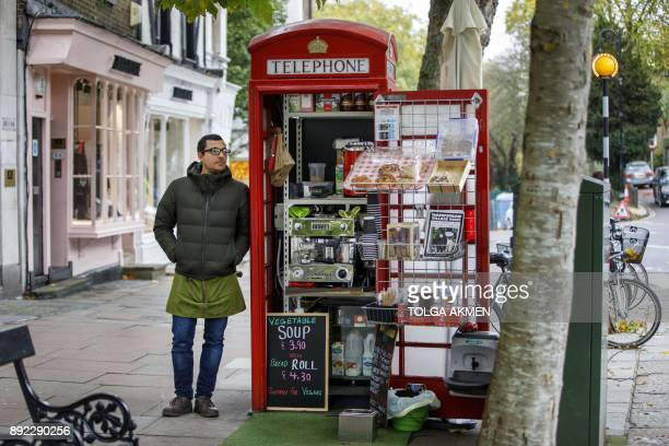 Umar Khalid poses outside the red telephone box from which he runs a coffee shop in Hampstead Heath north London on October 20 2017 Facing extinction...