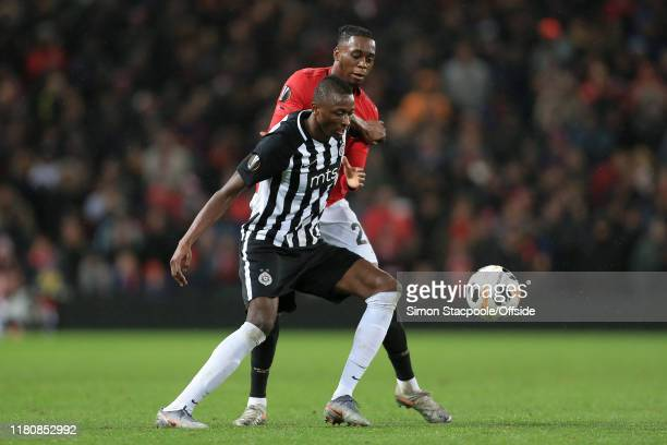 Umar Sadiq of Belgrade battles with Aaron WanBissaka of Man Utd during the UEFA Europa League group L match between Manchester United and Partizan at...