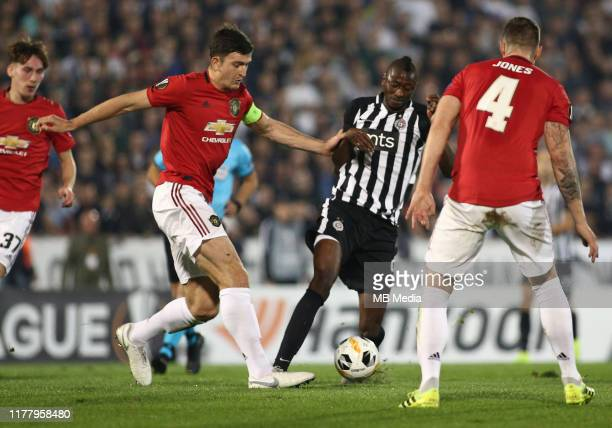 Umar Sadiq of Partizan and Harry Maguire of Manchester United during the UEFA Europa League group L match between Partizan and Manchester United at...