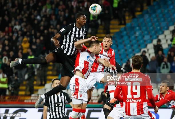 Umar Sadiq of Partizan jump for the ball over Milos Degenek and Milan Rodic of Crvena Zvezda during the Super Liga match between FK Crvena Zvezda and...