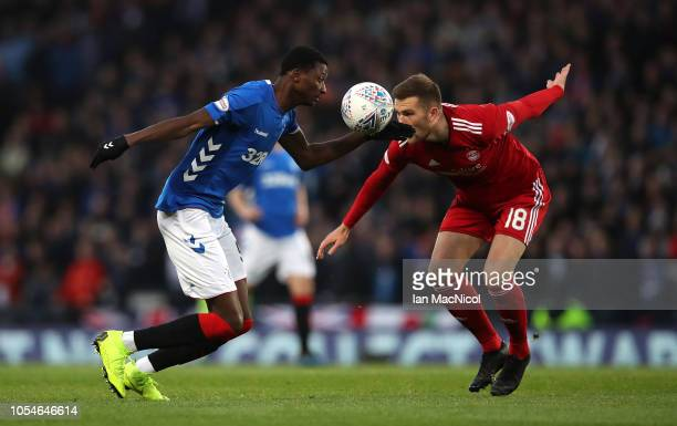 Umar Sadiq of Rangers battles for the ball with Michael Devlin of Aberdeen during the Betfred Scottish League Cup Semi Final between Aberdeen and...