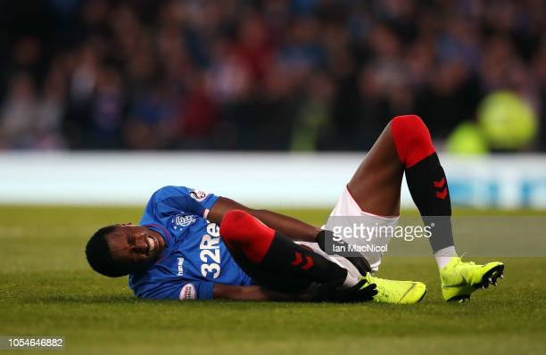 Umar Sadiq of Rangers grimaces whilst holding his ankle following a challenge during the Betfred Scottish League Cup Semi Final between Aberdeen and...
