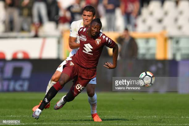 Umar Sadiq of Torino FC is challenged by Hector Moreno of AS Roma during the Serie A match between Torino FC and AS Roma at Stadio Olimpico di Torino...
