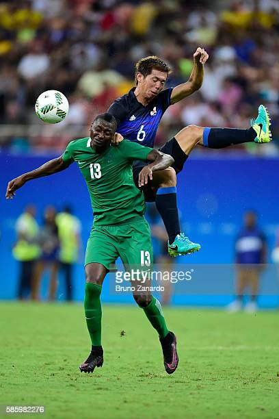 Umar Sadiq player of Nigeria battles for the ball with Tsukasa Shiotani player of Japan during 2016 Summer Olympics match between Japan and Nigeria...