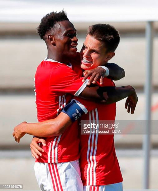 Umaro Embaló is congratulated by team-mate Tiago Dantas after scoring his side's second goal during the UEFA Youth League 2019/20 Semi-final match...