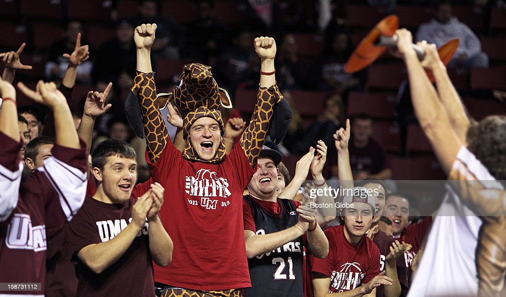 UMass hosted Harvard University in a 10 a.m. college basketball game at the Mullins Center on the UMass campus. Here UMass fans get 'Pumped Up' by a man pretending to struggle to lift a basketball barbell that is actually made of a paper product.