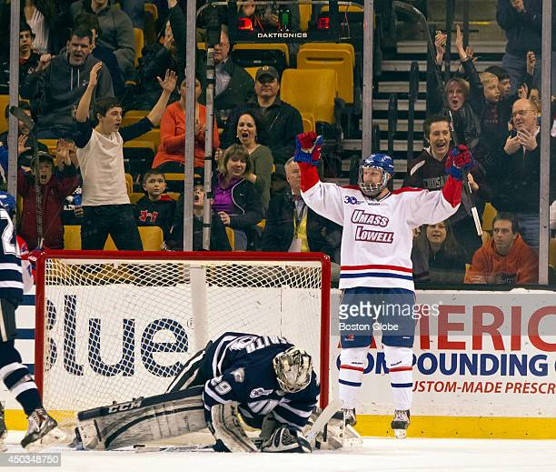 UMass Lowell River Hawks AJ White celebrates his goal behind University of New Hampshire Wildcats goalie Casey DeSmith during first period action of...