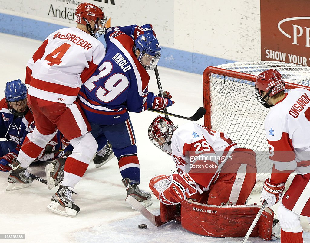 UMass Lowell River Hawks forward Derek Arnold (#29) walked in on BU goalie Matt O'Connor, (#29) but was denied on this shot during the second period. Boston University men's ice hockey, action and reaction. BU plays UMass Lowell at Agganis Arena.