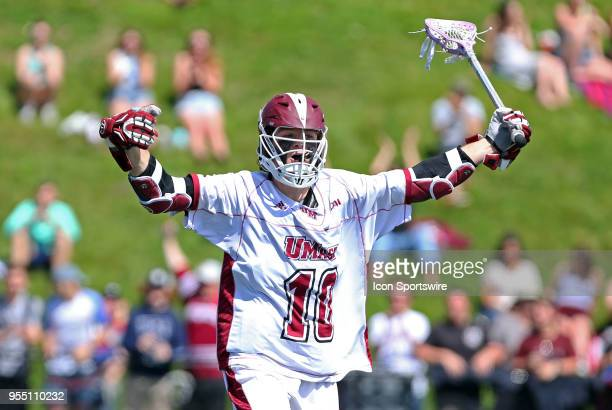 UMass Minutemen attackman Chris Connolly celebrates after scoring a goal during the CAA Lacrosse Championship game between Towson Tigers and UMass...