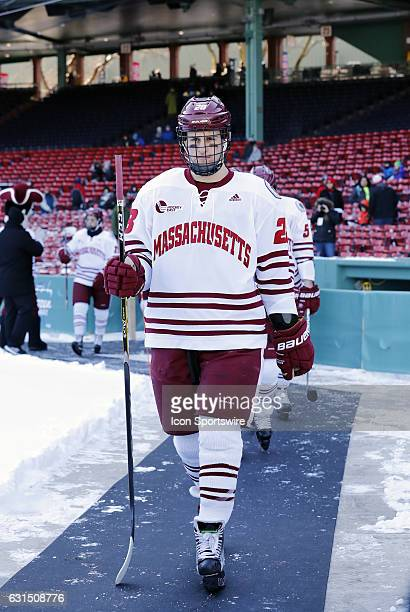UMass Minutemen defenseman Jake McLaughlin walks to the rink during a Frozen Fenway NCAA Men's Division 1 hockey game between the Boston University...