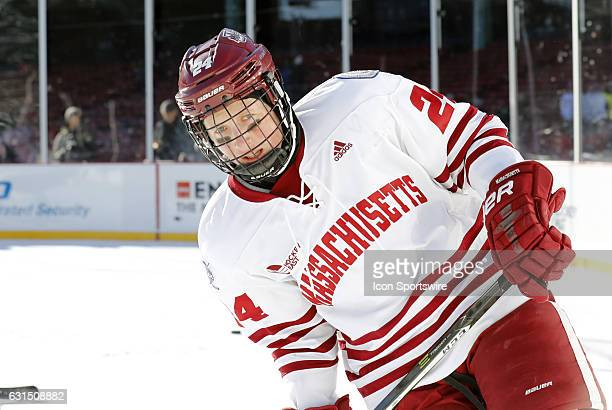 UMass Minutemen defenseman Shane Bear skates during warm up before a Frozen Fenway NCAA Men's Division 1 hockey game between the Boston University...