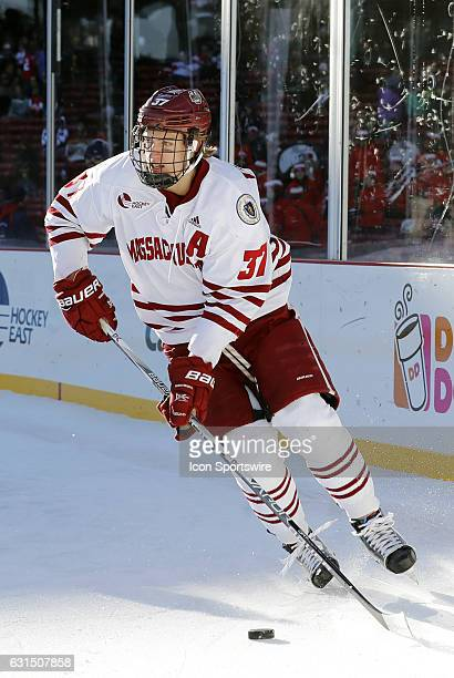 UMass Minutemen defenseman William Lagesson skates with the puck during a Frozen Fenway NCAA Men's Division 1 hockey game between the Boston...