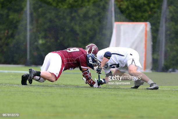 UMass Minutemen faceoff Noah Rak and Yale Bulldogs midfielder Conor Mackie during the first round of the NCAA Division I Men's Championship match...