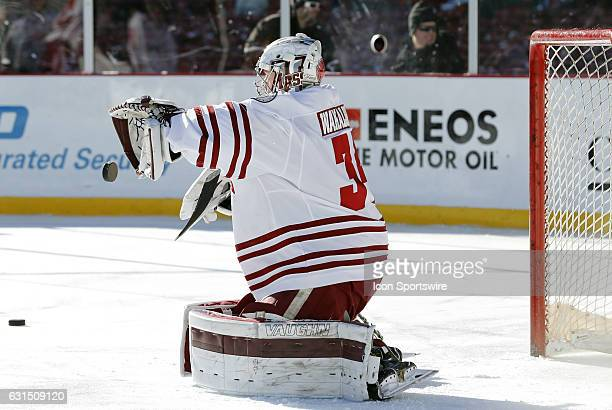 UMass Minutemen goaltender Alex Wakaluk makes a save in warm up before a Frozen Fenway NCAA Men's Division 1 hockey game between the Boston...