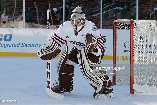 UMass Minutemen goaltender Ryan Wischow eyes a defensive zone face off during a Frozen Fenway NCAA Men's Division 1 hockey game between the Boston...