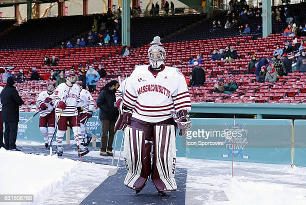 UMass Minutemen goaltender Ryan Wischow leads his team to the rink during a Frozen Fenway NCAA Men's Division 1 hockey game between the Boston...