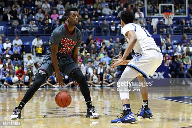 UMass Minutemen guard CJ Anderson and Rhode Island Rams guard Jeff Dowtin in action during the seconod half of an NCAA basketball game between UMass...