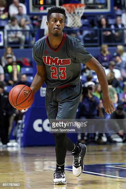 UMass Minutemen guard CJ Anderson brings the ball up court during the second half of an NCAA basketball game between UMass Minutemen and Rhode Island...