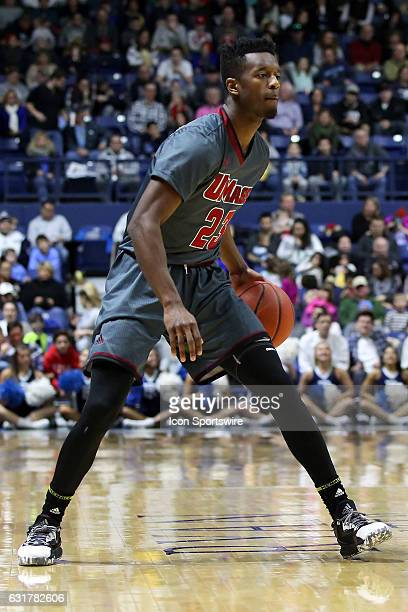 UMass Minutemen guard CJ Anderson dribbles the ball during the second half of an NCAA basketball game between UMass Minutemen and Rhode Island Rams...