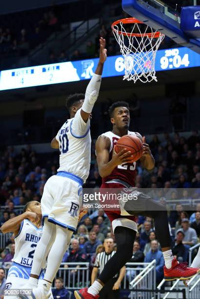 UMass Minutemen guard CJ Anderson drives past Rhode Island Rams forward Cyril Langevine during a college basketball game between UMass Minutemen and...